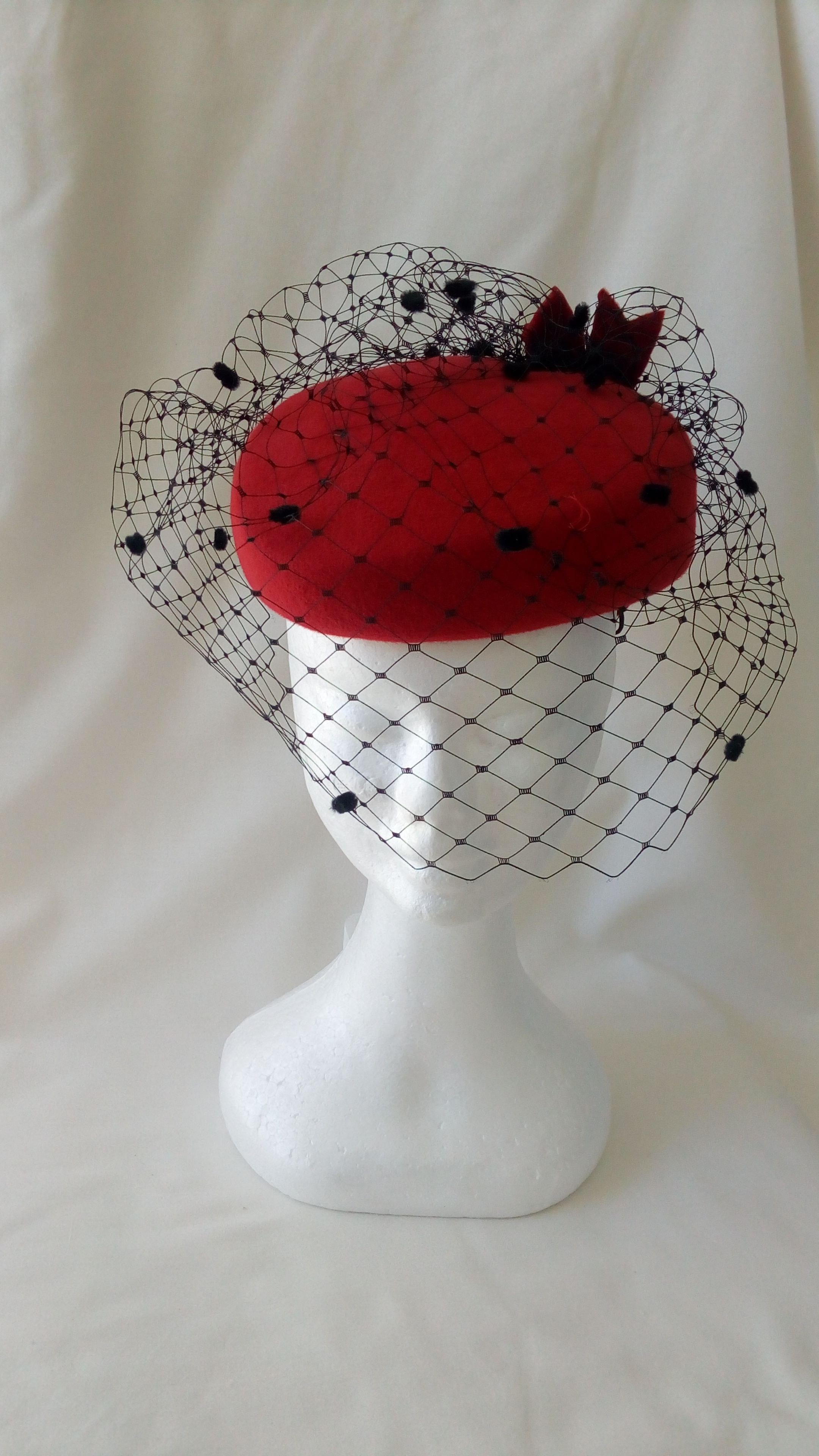 Red felt heart-shaped hat with black veiling. Visit. February 2019 eea772507197