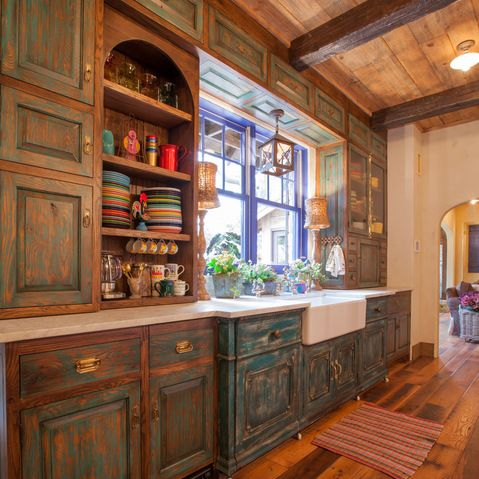 Mexican style kitchen design with pewter pulls and for Mexican style kitchen pictures