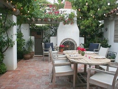 Outdoor dining with wood burning fireplace the one about for Spanish outdoor fireplace
