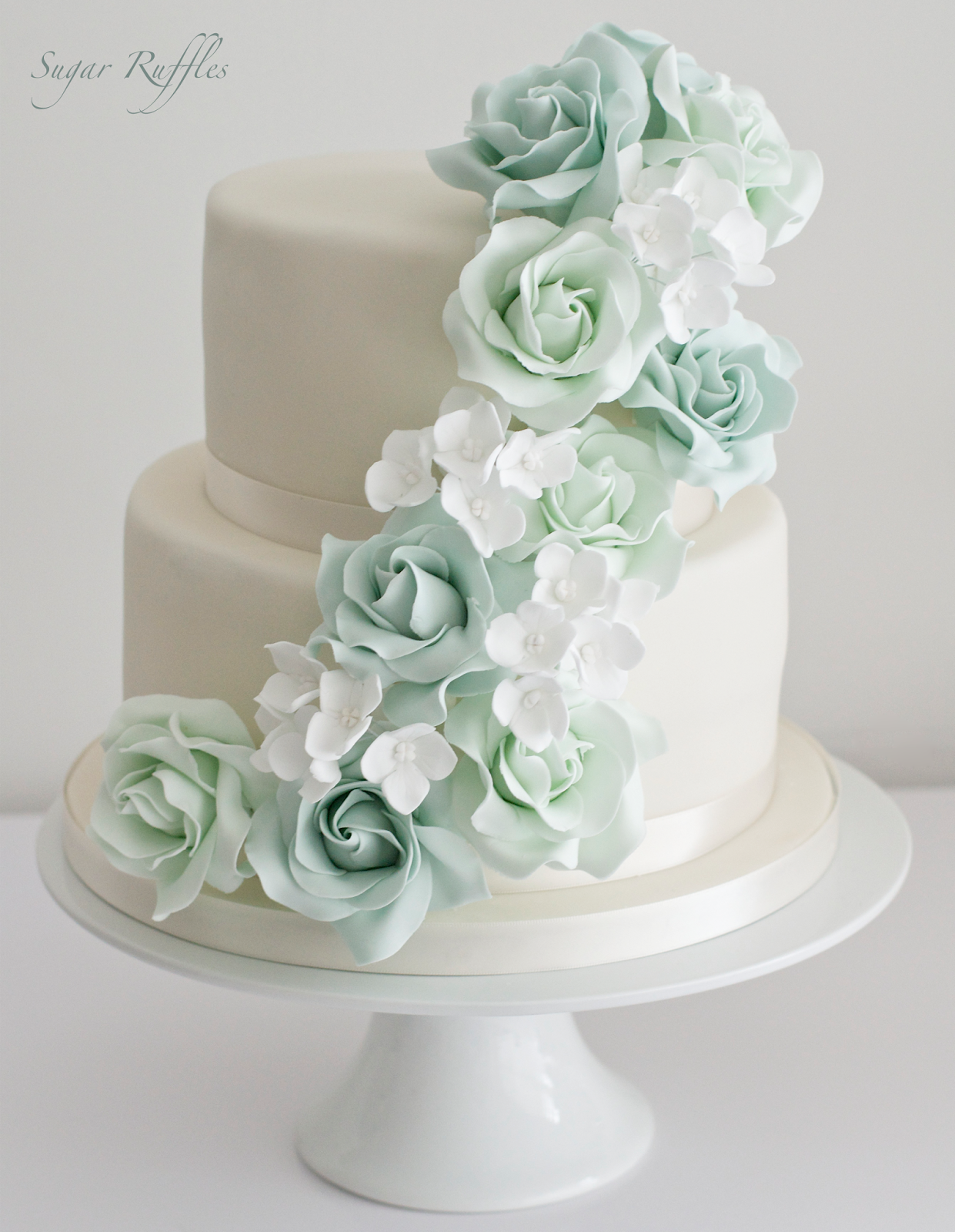 wedding cake with cascading roses - Google Search