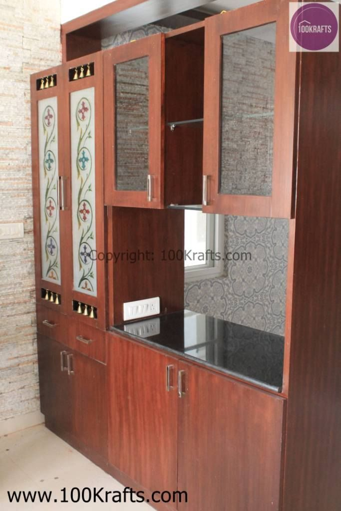 Crockery Unit Plus Puja Made In Veneer Also Acts As Partition Between The Living And RoomKitchen