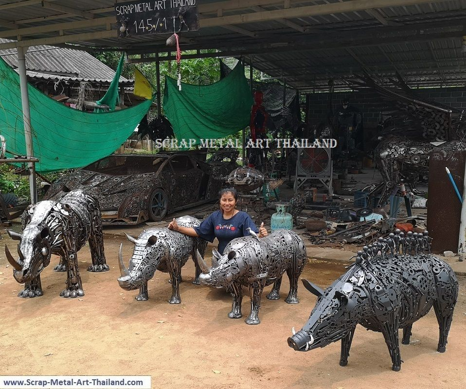 baby rhino statues, and life size wild boar sculpture, with