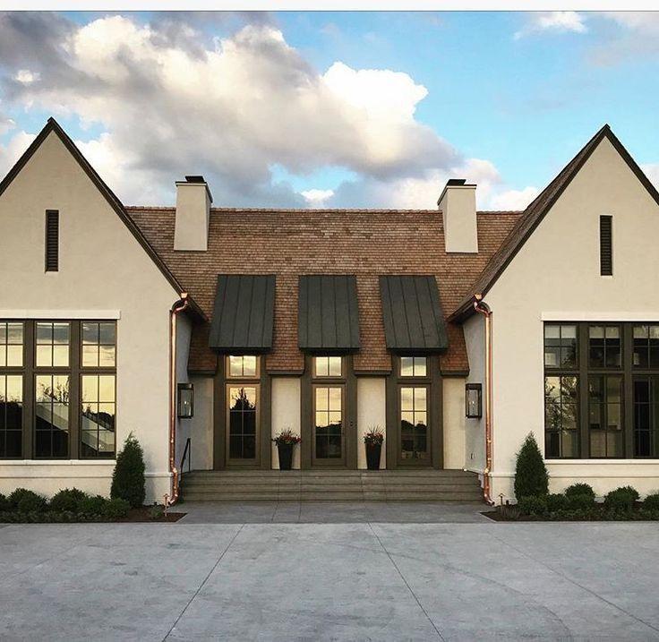 Modern symmetrical stucco home | Modern farmhouse exterior ...