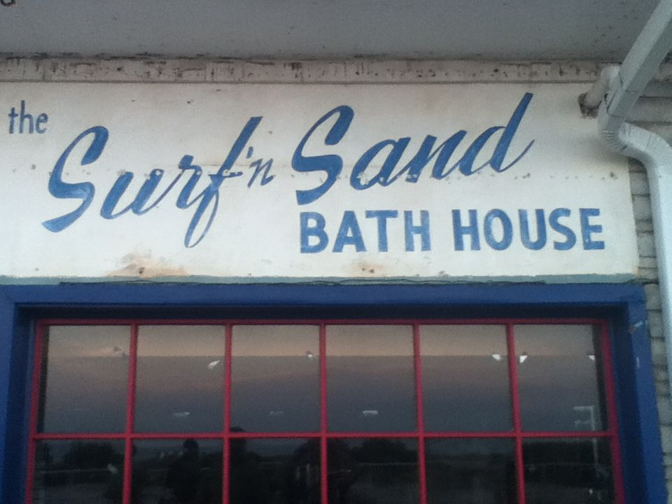 "old sign for ""The Surf'n Sand Bath House"" under the ""Old"