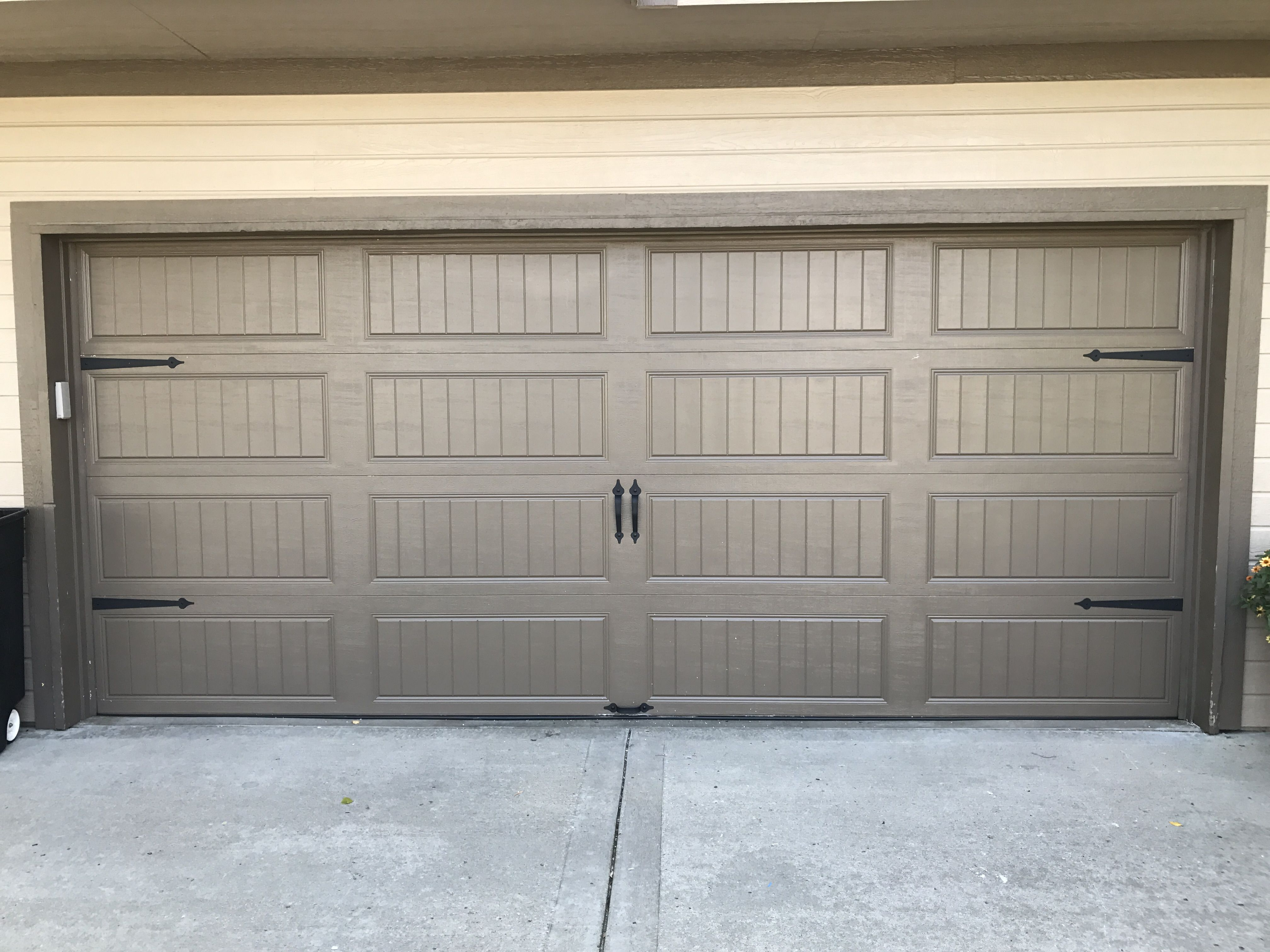 Double Wide Carriage Style Garage Door With Decorative Handles And Straps Carriage Style Garage Doors Garage Doors Garage Door Repair Service