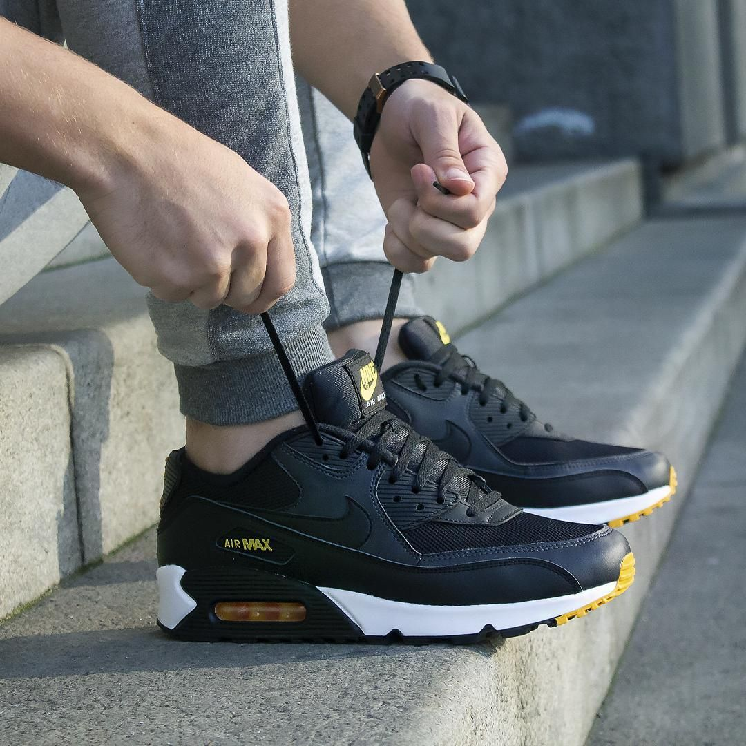 Nike Air Max 90 Essential black with yellow details. Heavy