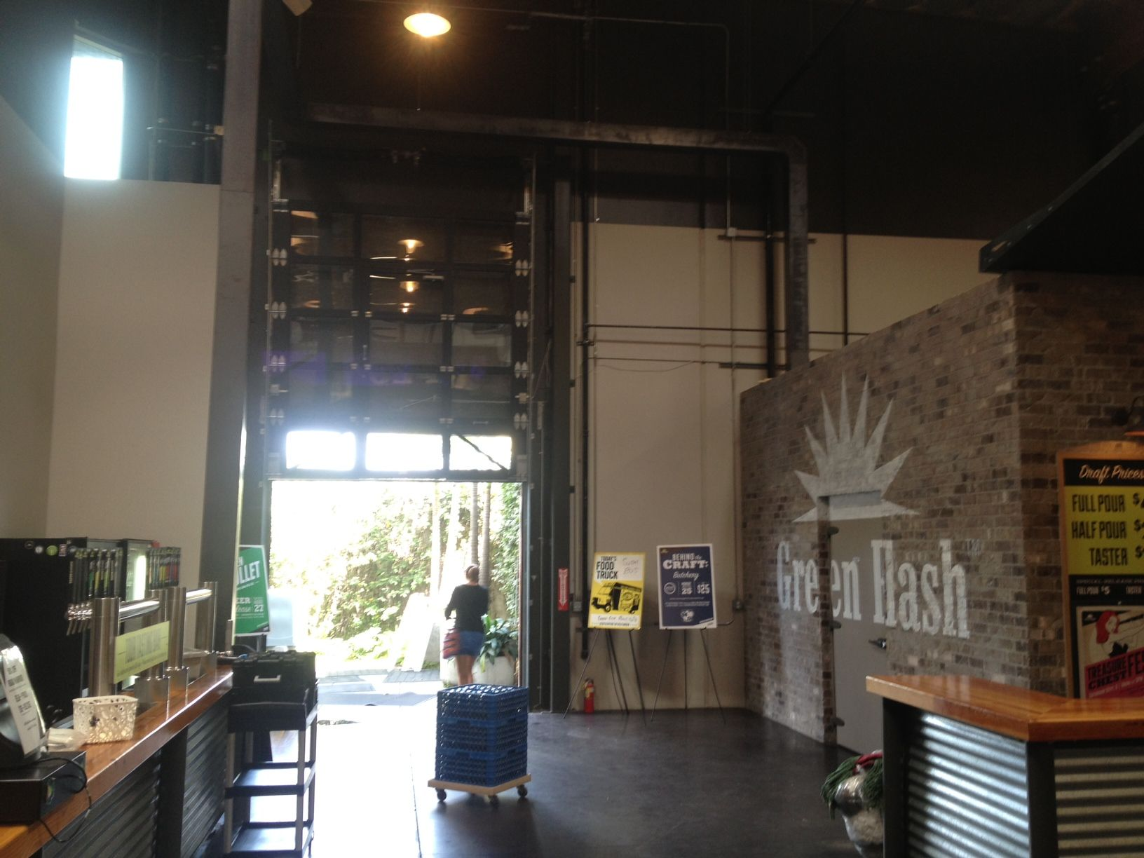 Glass garage door interior - Green Flash Brewery In California With Welded Arm R Lite Glass Garage Door And