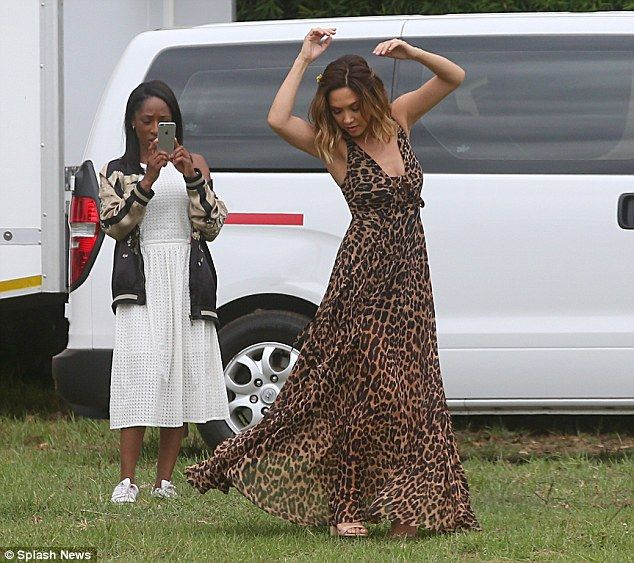 Do your thing: The mother-of-two put on a flirty display as she played up to the cameras during the fun shoot