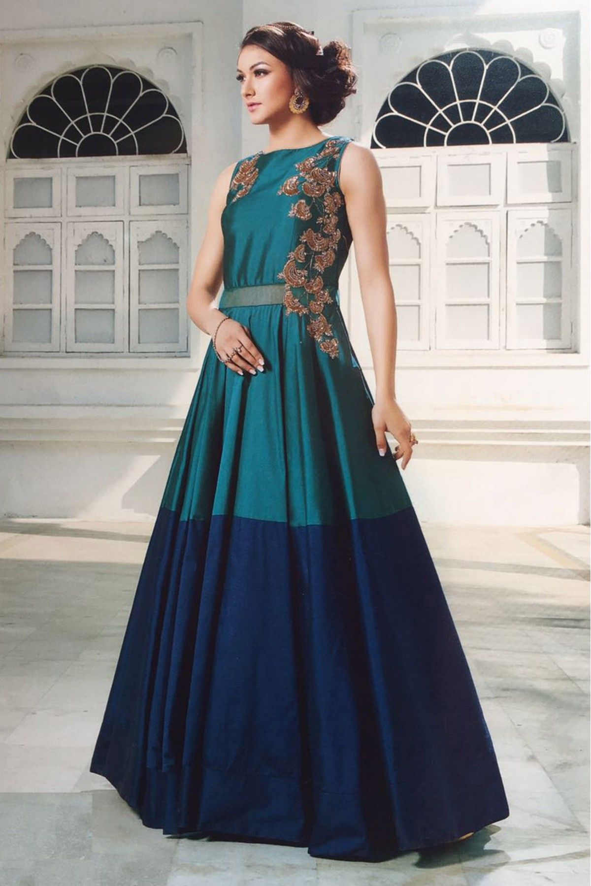 761e0a9f80d0 This super stylish Tapeta Silk Gownis exclusively crafted with Hand Work .  The Blue Colour Gown comes with matching Bottom. This Gown can be worn on  any ...