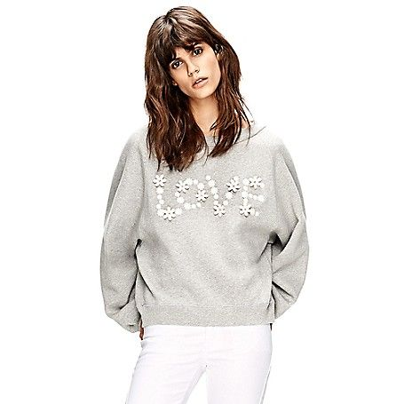 Tommy Hilfiger women's fleece. TH Collection, Spring 2015. Crocheted daisies spell love on our famously soft fleece. Cut slightly cropped with batwing sleeves for a feminine twist on the classic.<br>• Oversized fit.<br>• 100% cotton.<br>• Hand-sewn applique.<br>• Machine washable.<br>• Imported.<br><br>