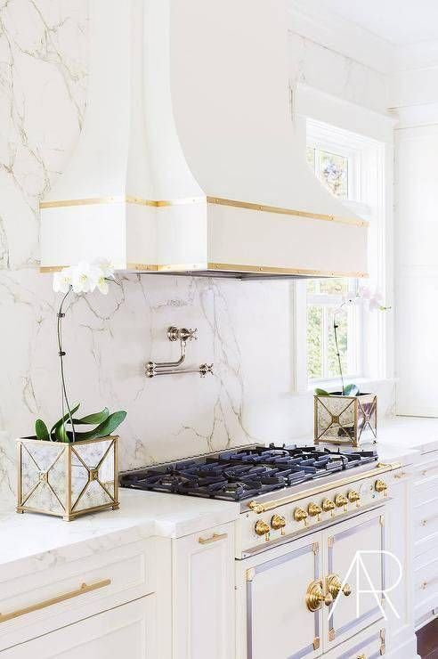 Alyssa rosenheck laura burleson interiors white and gold kitchen features cabinets adorned with long pulls paired silestone countertops also best new home ideas images in future house decor rh pinterest