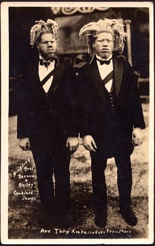 1899 Willie and George Muse were kidnapped from their rural Virginia home, sold and put to work with Ringling Brothers as Eko and Iko, Ambassadors from Mars. They were not paid for their work.