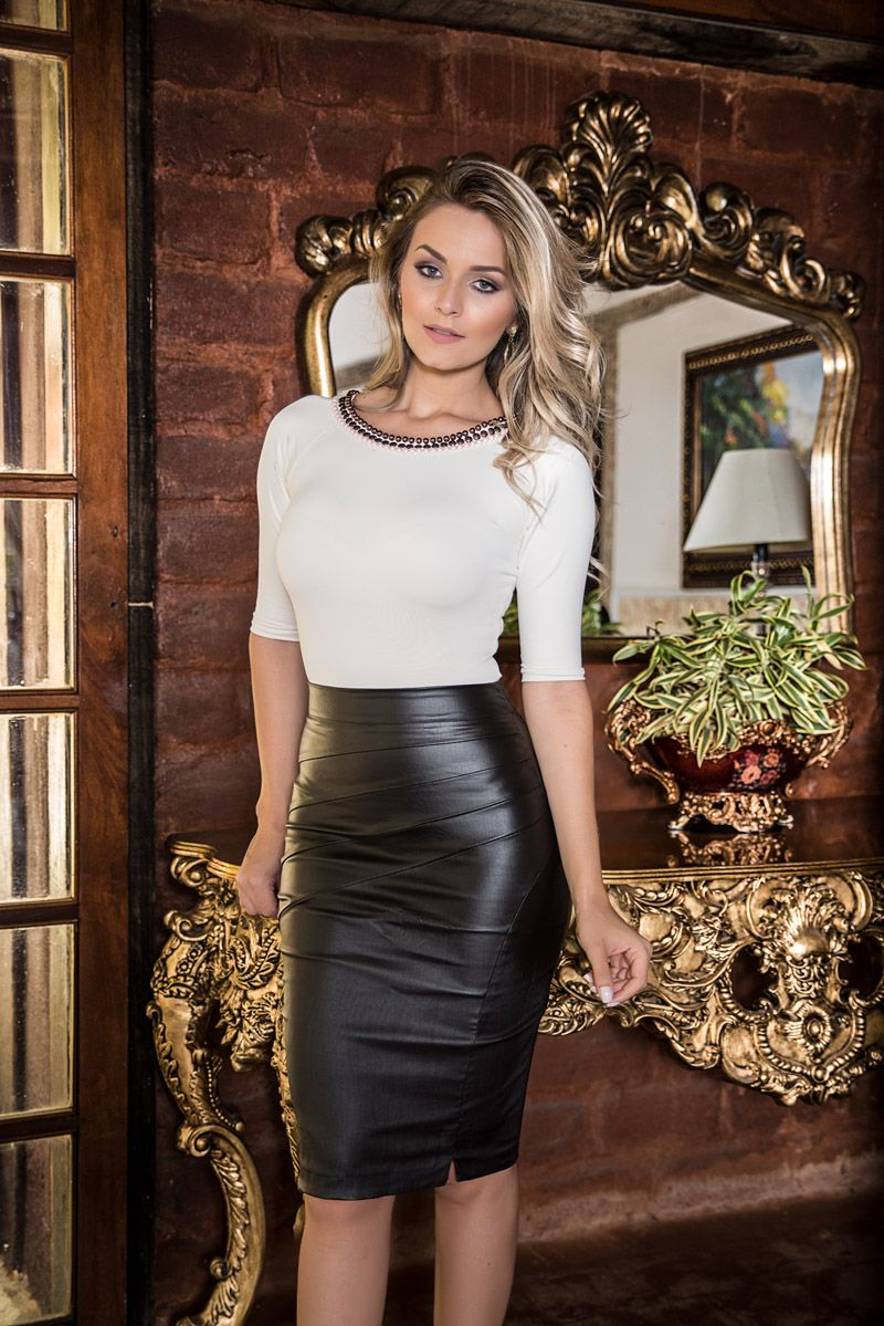 Blonde in black leather pencil skirt and white top  8afea0d3002