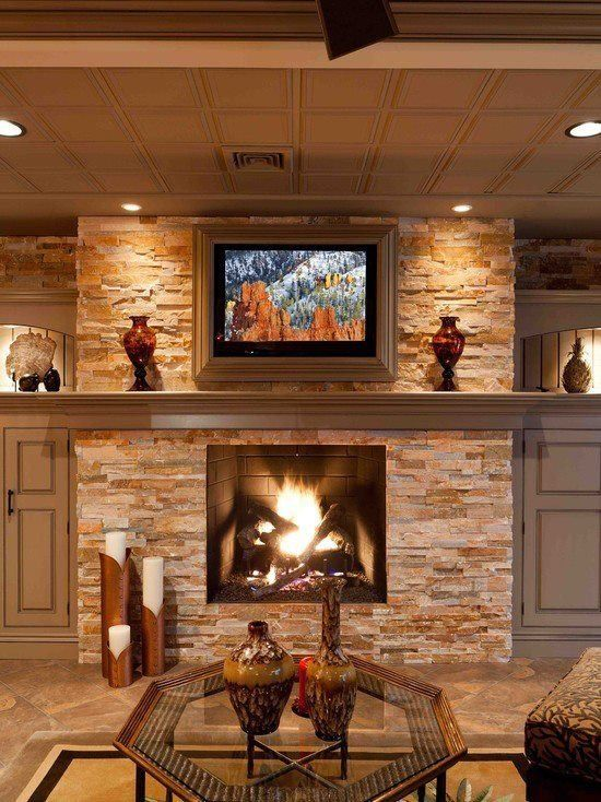 Stone Fireplace With Ceiling Accent Lights Basement Design Basement Remodeling Basement Decor