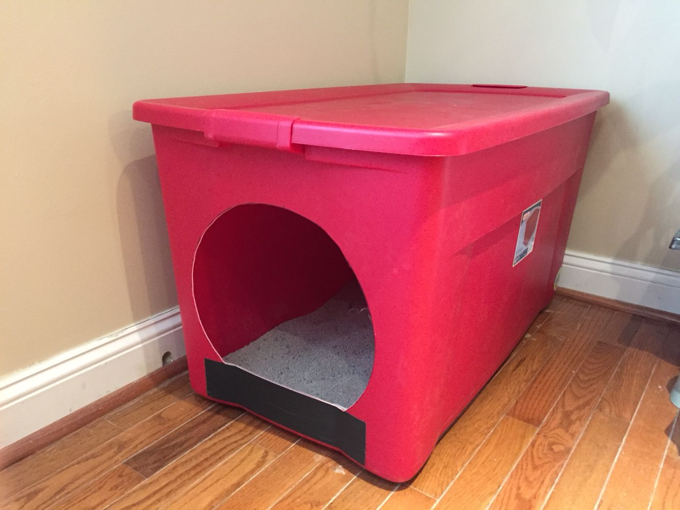 Homemade litter box from a large storage container Made for our