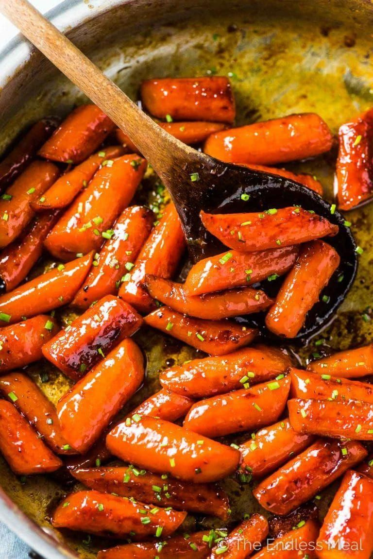 SAVE FOR LATER! Honey Roasted Carrots (or candied carrots, as we like to call them) are a sweet, delicious, and healthy vegetable side dish. The easy to make carrots are coated in a honeyglaze then roasted until tender and caramelized. They are totally addictive!
