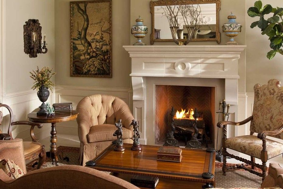 charming empty living room fireplace | Charming Mediterranean inspired living room and fireplace.