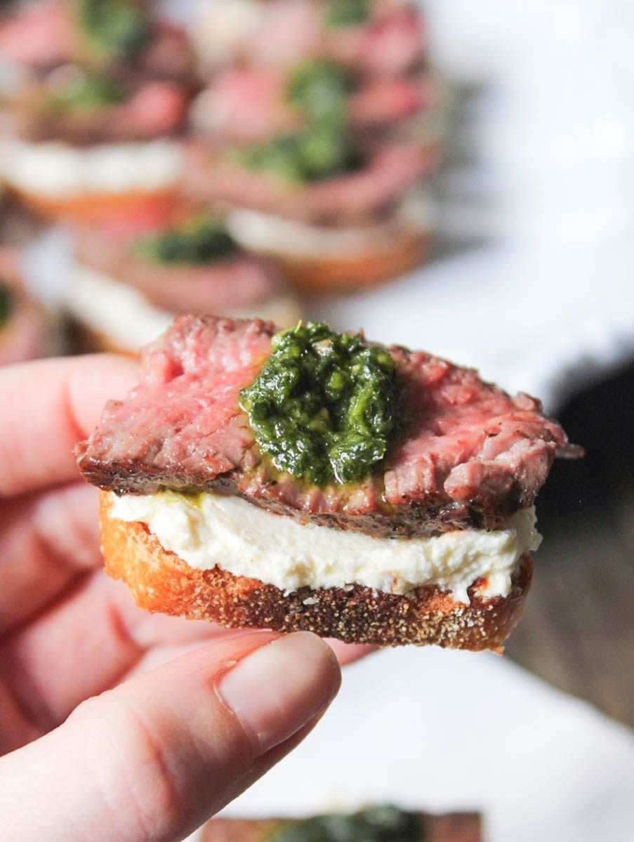 Beef Tenderloin Crostini with Whipped Goat Cheese and Pesto - Domesticate ME
