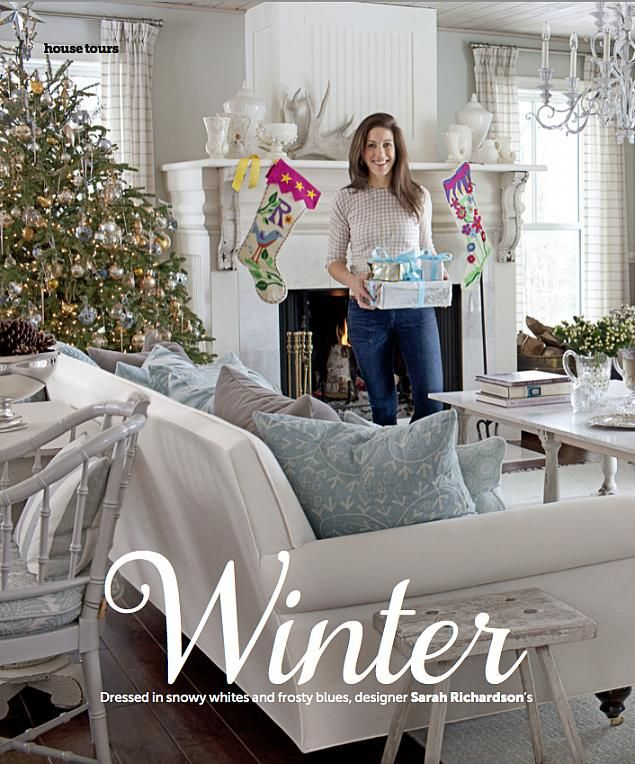 Sarah holding gifts in her Creemore home featured in the December