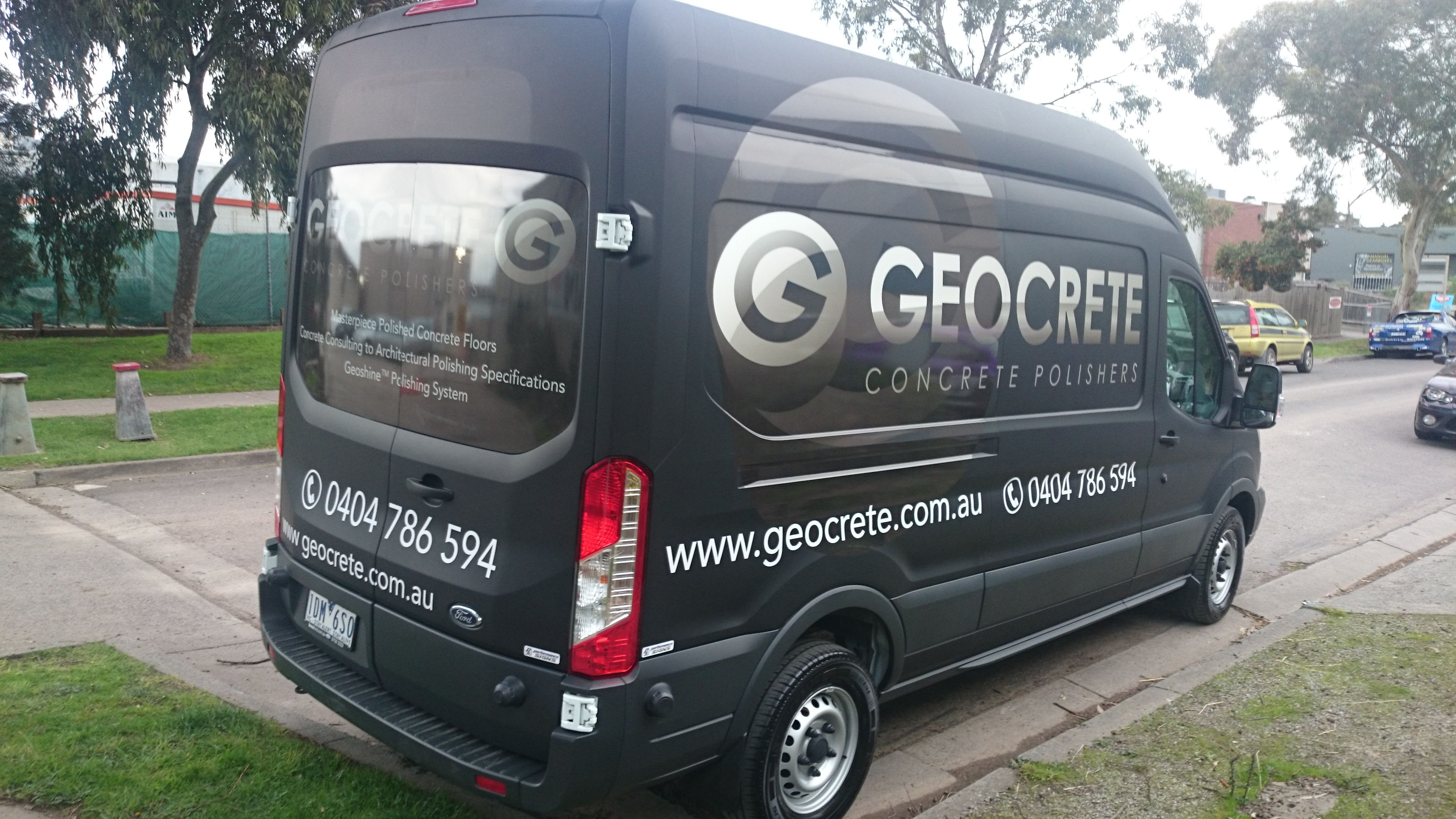 f24aecfe52 Gloss branding over matte black film over white Ford Transit Van Signwriting