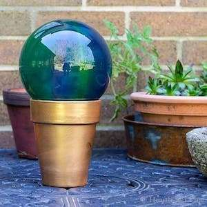 100 Creative DIY Garden Art Ideas is part of Diy garden decor, Unique garden art, Garden art, Garden art diy, Garden globes, Gazing ball - Brighten up your garden with these unique DIY garden art ideas that will add a splash of color and charm to your yard without breaking the budget