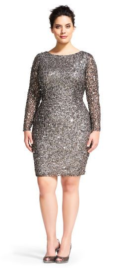 a7f5e47b Sequins light up this eye-catching, long sleeved cocktail dress. A scooped  back creates an alluring silhouette.This Adrianna Papell design has been  made ...