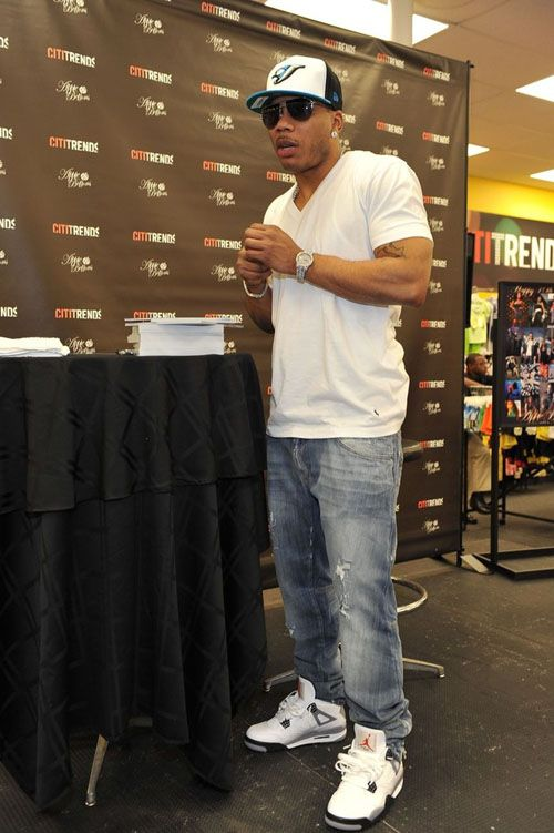 Nelly wearing the Air Jordan Retro 4