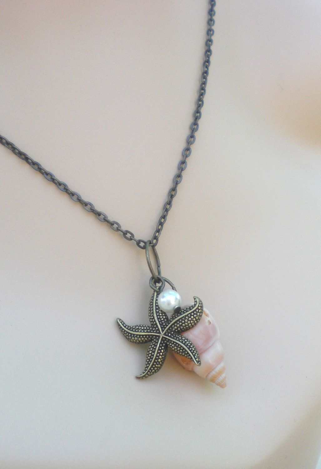 Antiqued Starfish and Shell with Swarvoski Pearl - Seaside Charm Drop Necklace. $16.75, via Etsy.