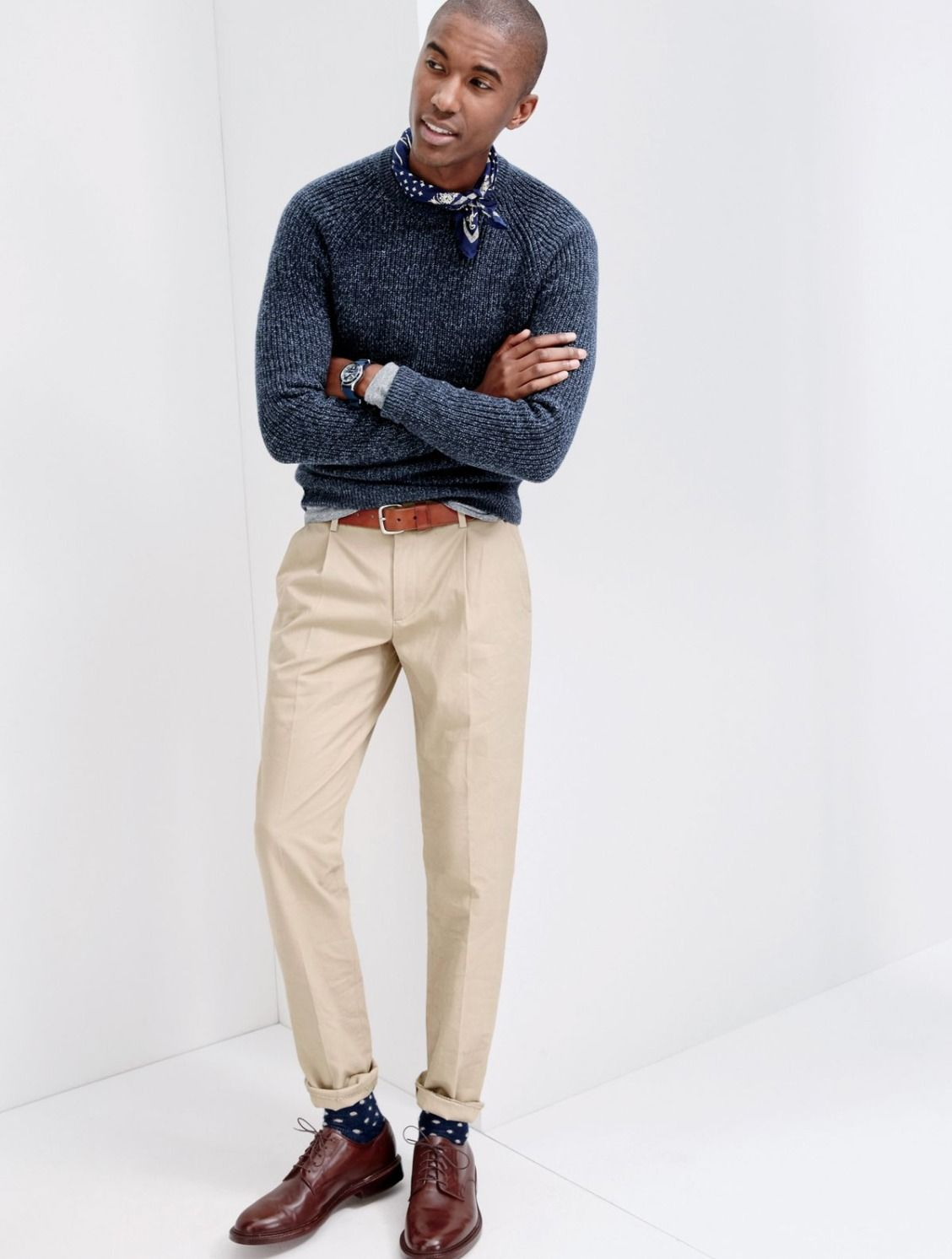 How it's done. Pleats. J.Crew men's slim pleated pants have plenty of sophistication. To make them look a little less formal, try wearing them with a J.Crew rugged sweater and a Garments for Good bandana.