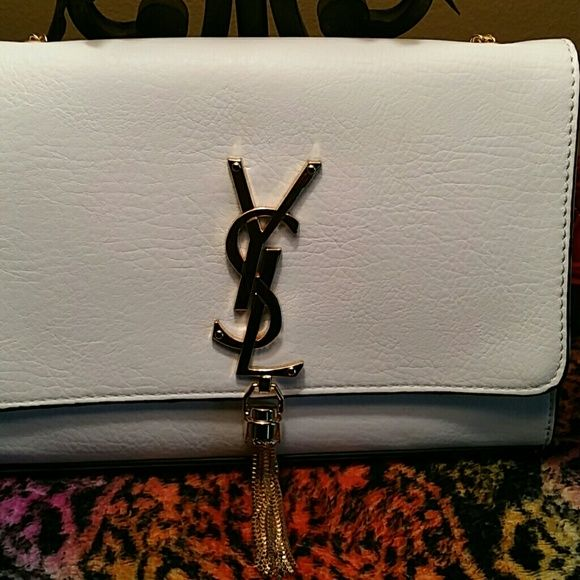 Saint Laurent's Cassandra Monogram Cross body bag. Ivory Leather Small cross body Monogram bag. Cassandra Monogram can be worn across the body or over the shoulder. Very Rich in texture and high quality and credentials the Ivory Leather Cassandra cross body bag will bring a luxurious account to a host of looks. It was originally designed and made in Italy. accented on the front flap with the label's tassels monogram in polished gold -tone metal that will not fades..also has a magnetic…