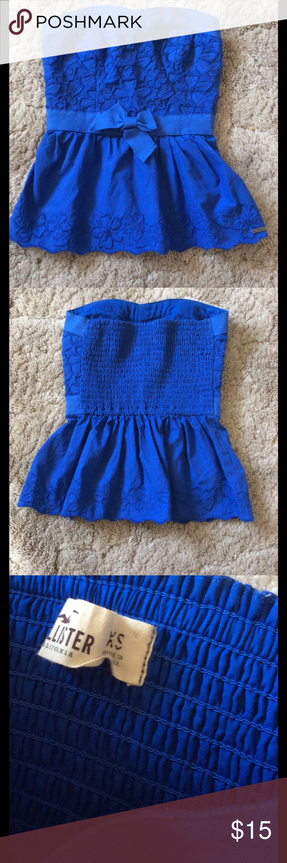 """Blue Strapless Peplum Top Pretty blue peplum hem strapless top by Hollister.  The back is elastic.  Has floral embroidered detail.  Length- 15"""",  Bust- 12"""",  Waist- 10.5"""".  Very good condition, worn lightly, smoke free home. Hollister Tops"""