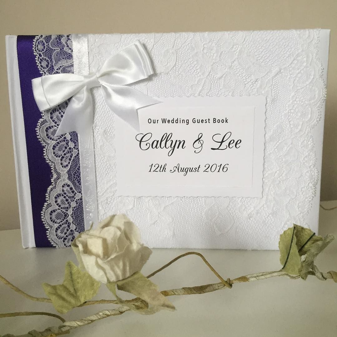 Our personalised wedding guestbook with purple ribbon goes