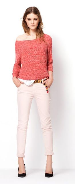 Pretty sharp black pumps with beige pants and orange-coral sweater.