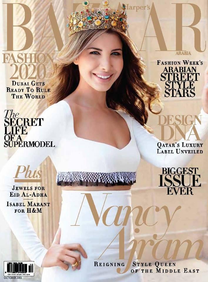 Nancy Ajram Stars the Cover of Harper's Bazaar Arabia wearing Dolce & Gabbana's crown, white cropped top & high-waist skirt
