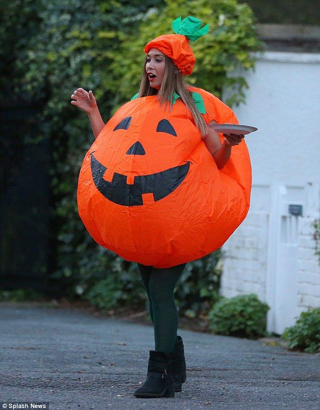 Myleene Klass goes trick or treating dressed as a giant pumpkin