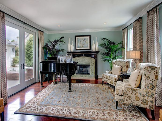 Baby Grand Piano Partially In Front Of Fireplace Paritally Large Doors