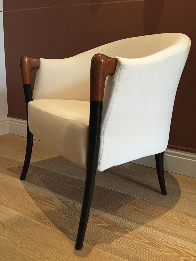 A pair of 1950\'s ebonised and cherry wood tub chairs, on sabre legs ...