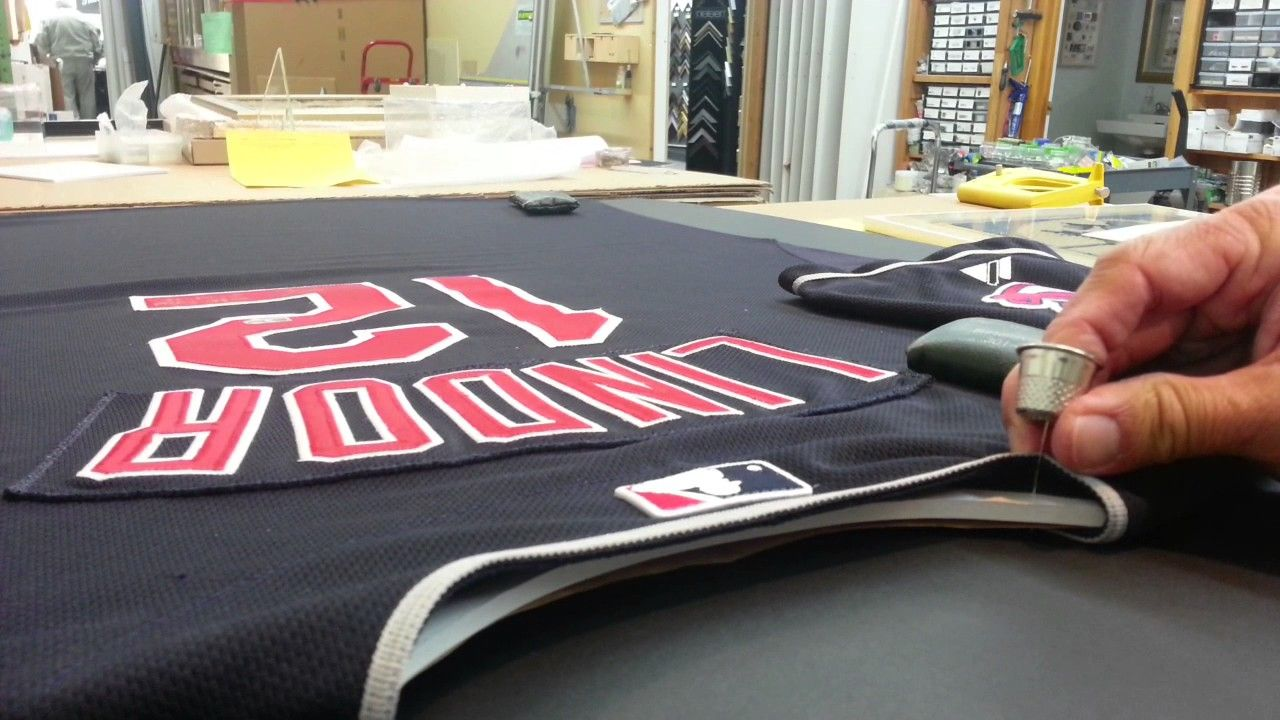 A really good tutorial on how to frame a sports jersey