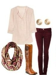 loose pale shirt; red jeans; brown boots; patterned scarf; gold earrings