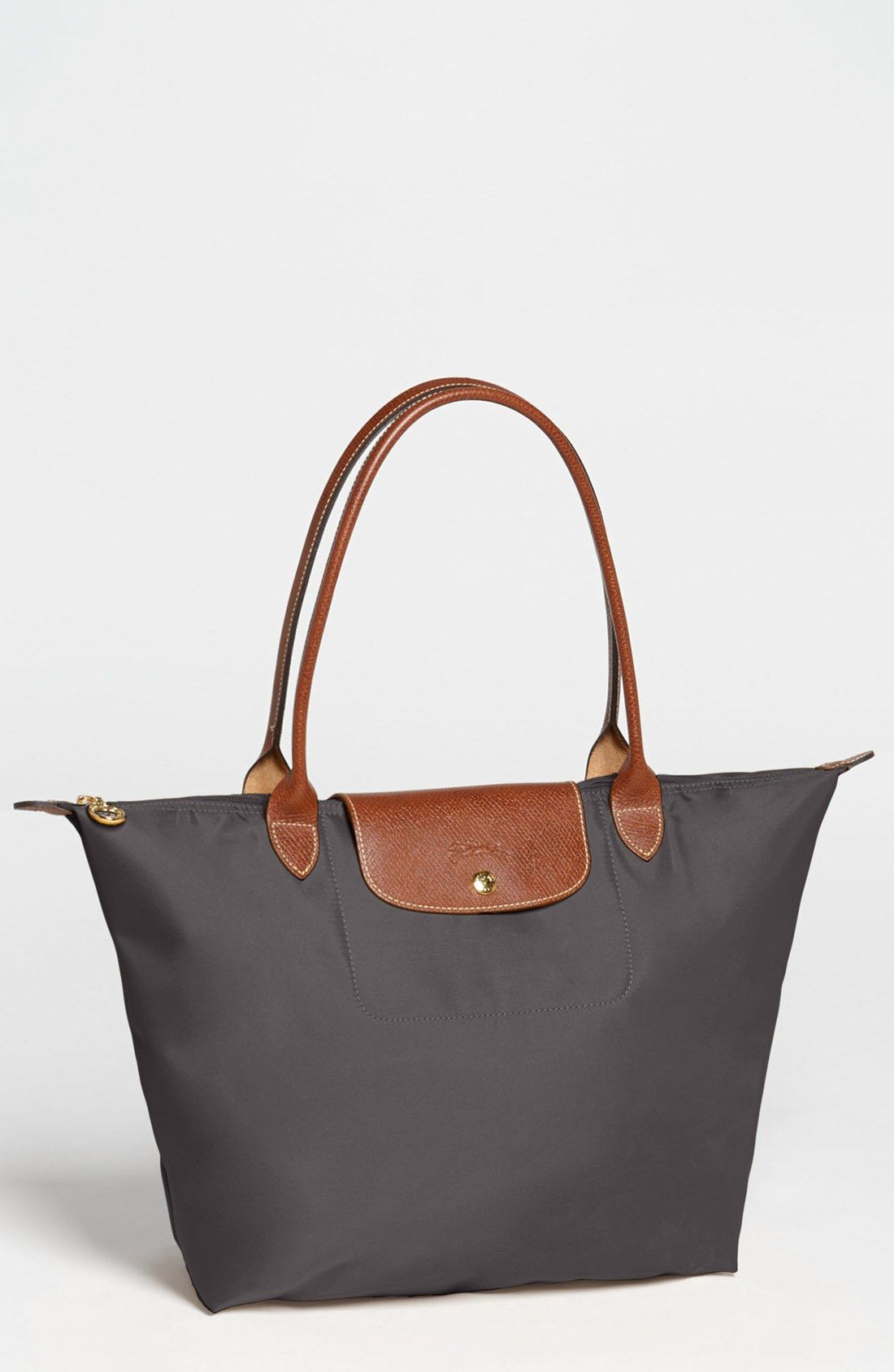 Longchamp  Large Le Pliage  Tote --in gunmetal or whatever brown color they  have. My current one is pretty dirty beat up  tattered. c9034e5aa0a40