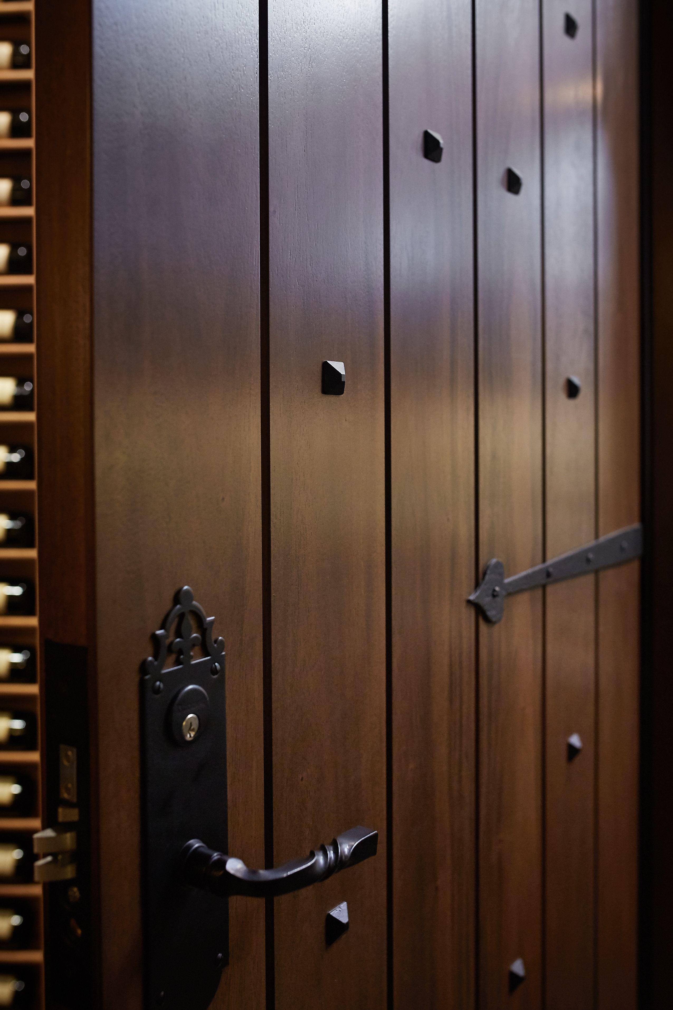Mahogany wine cellar door with accent hardware door by revel