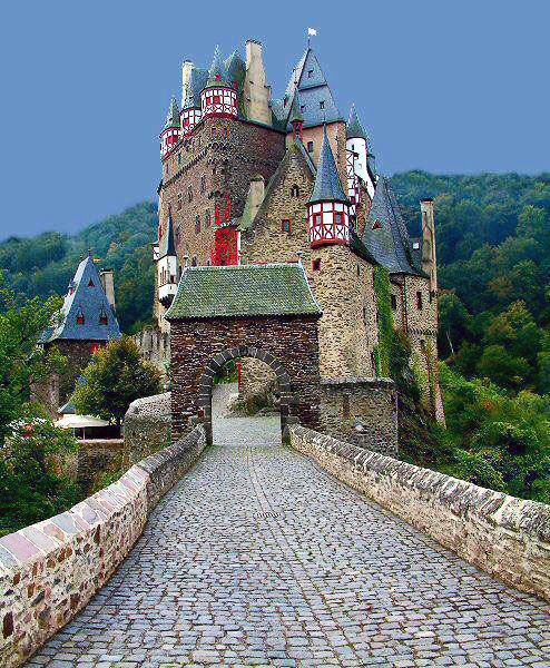 The Eltz Castle in Trier, Germany. This medieval castle is nestled in the hills above the Moselle River. It was once printed on a 500 Deutsche Mark note!