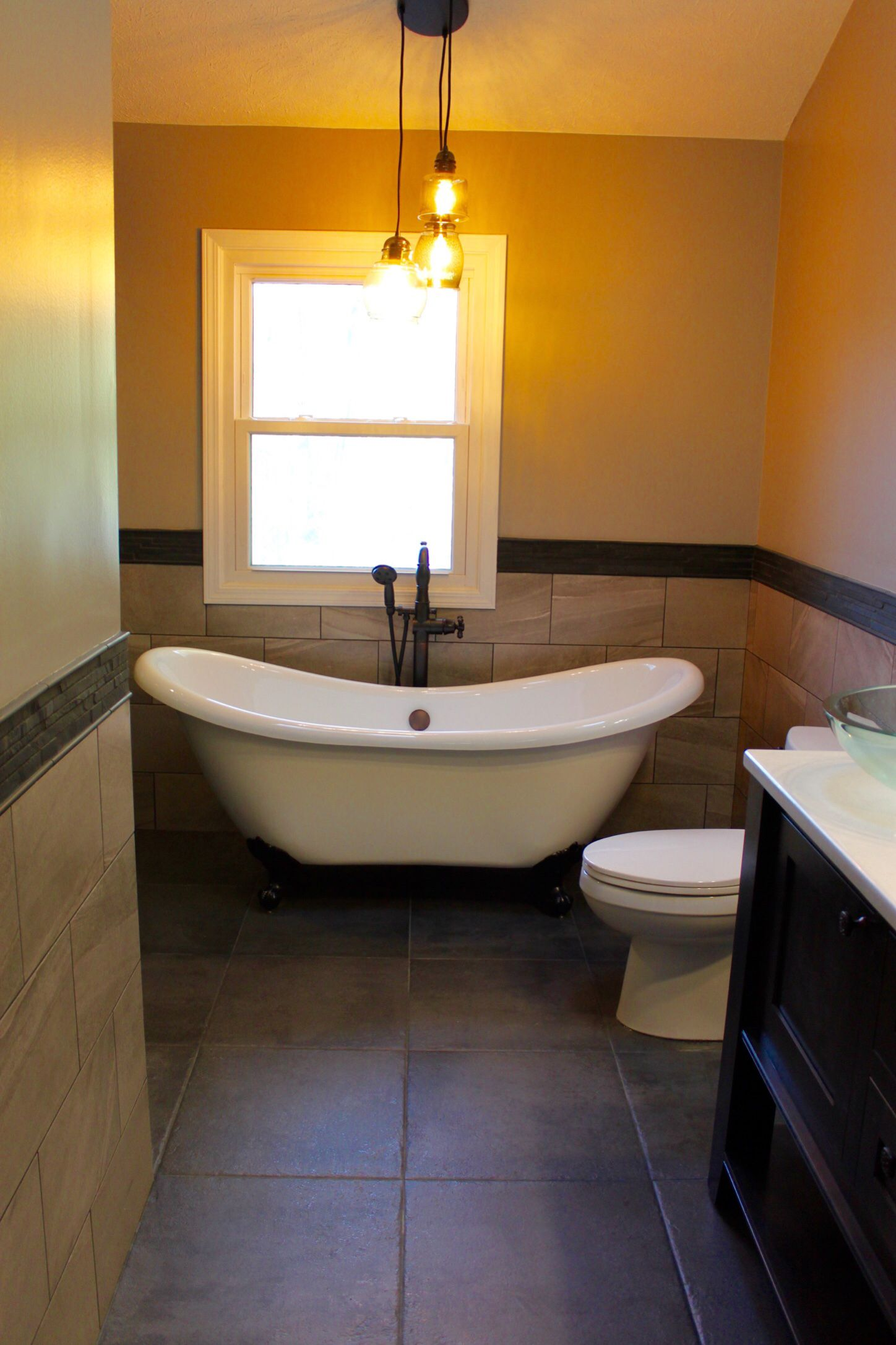This transitional master bathroom has warm tile throughout the room this transitional master bathroom has warm tile throughout the room to create a spa like setting with a claw foot bathtub warmlyyours radiant heated floors dailygadgetfo Images
