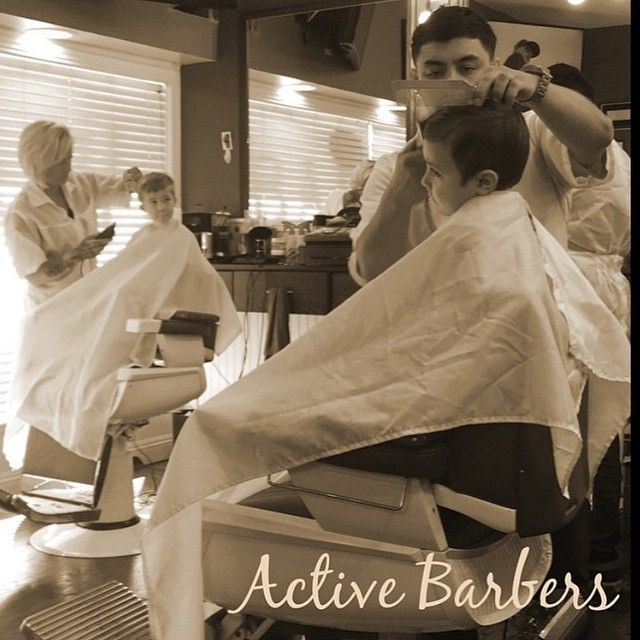 two boys getting slicked up at the barbershop