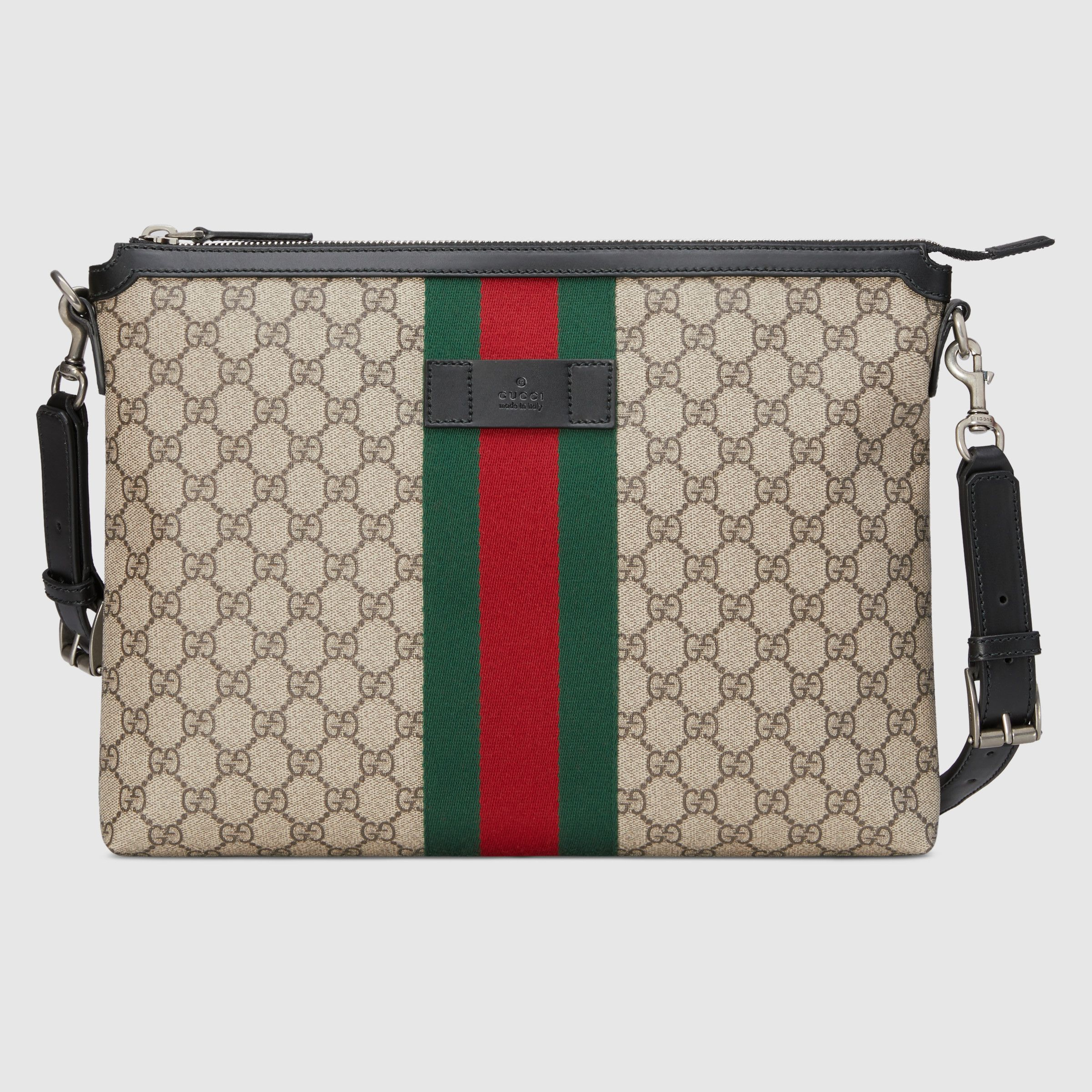 2ed5f7595 GG Supreme medium messenger bag in Beige/ebony GG Supreme canvas, a  material with low environmental impact, with black leather trim | Gucci  Men's Messenger ...