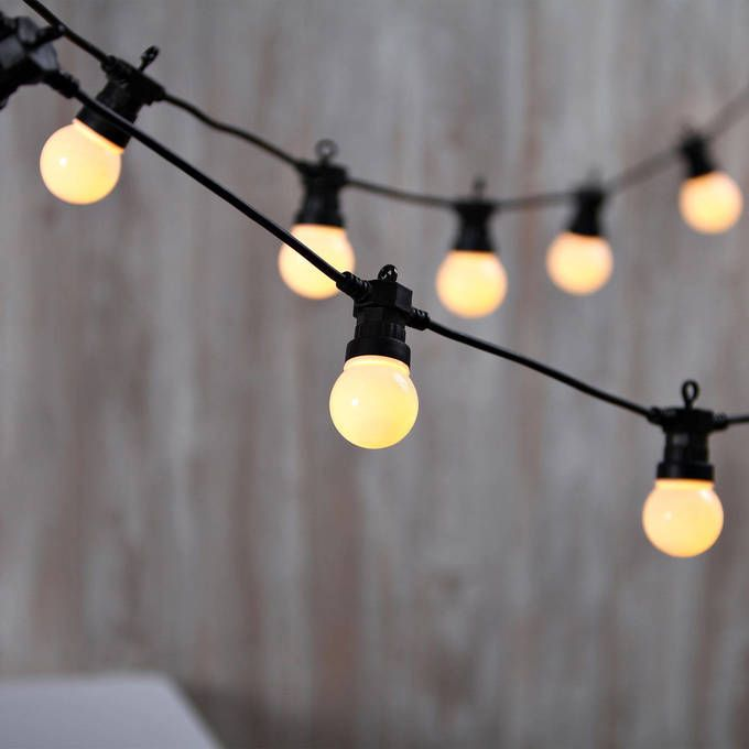 Warm white connectable frosted festoon plug in globe lights this set of festive string lights features twenty frosted globe bulbs each illuminated by five warm white led lights strung along a thirty three foot mozeypictures Choice Image