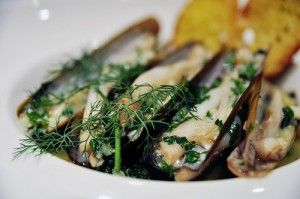 Razor clams sauteed with garlic, parsley and white wine