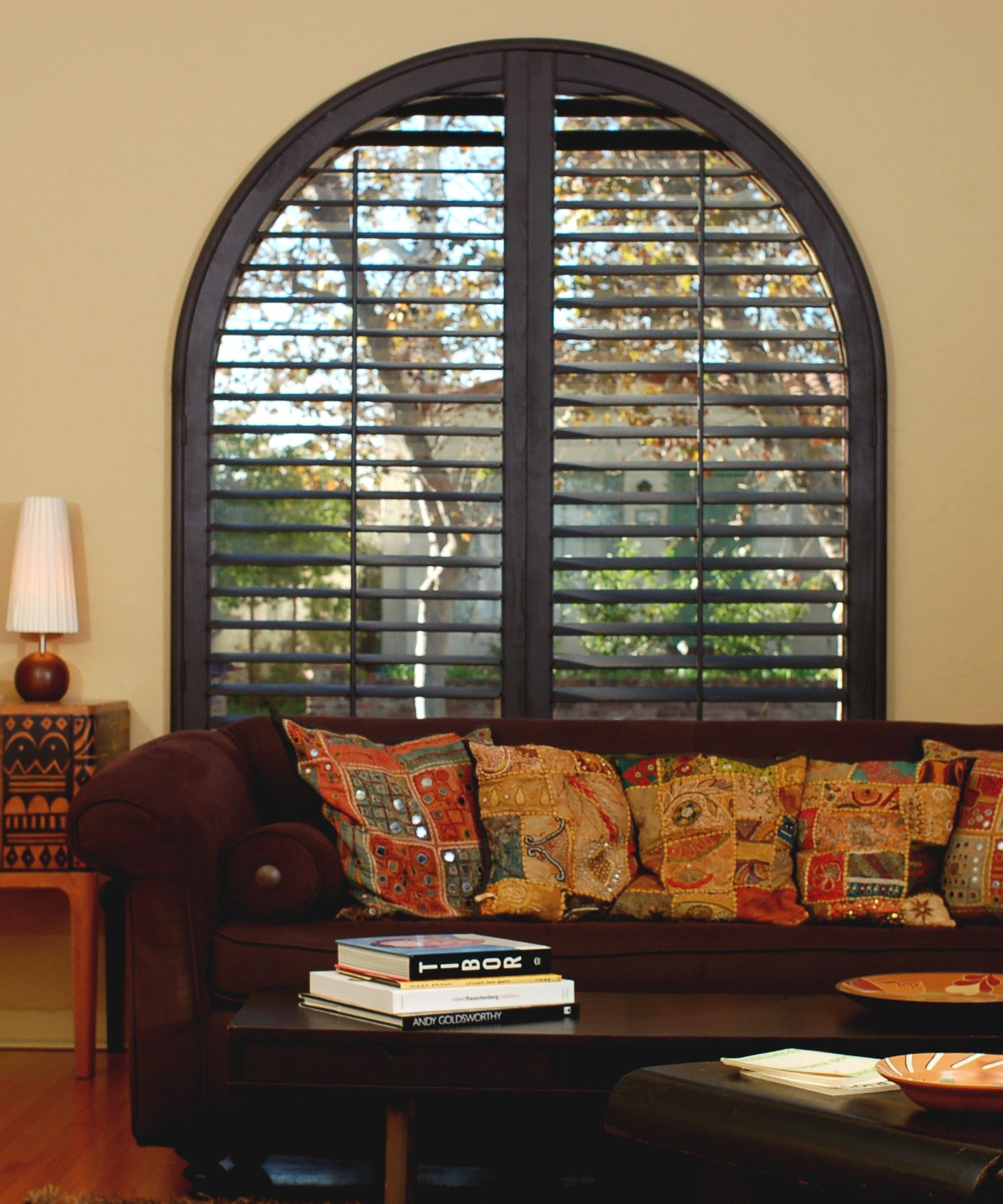 archedwindow plantationshutters stained decor
