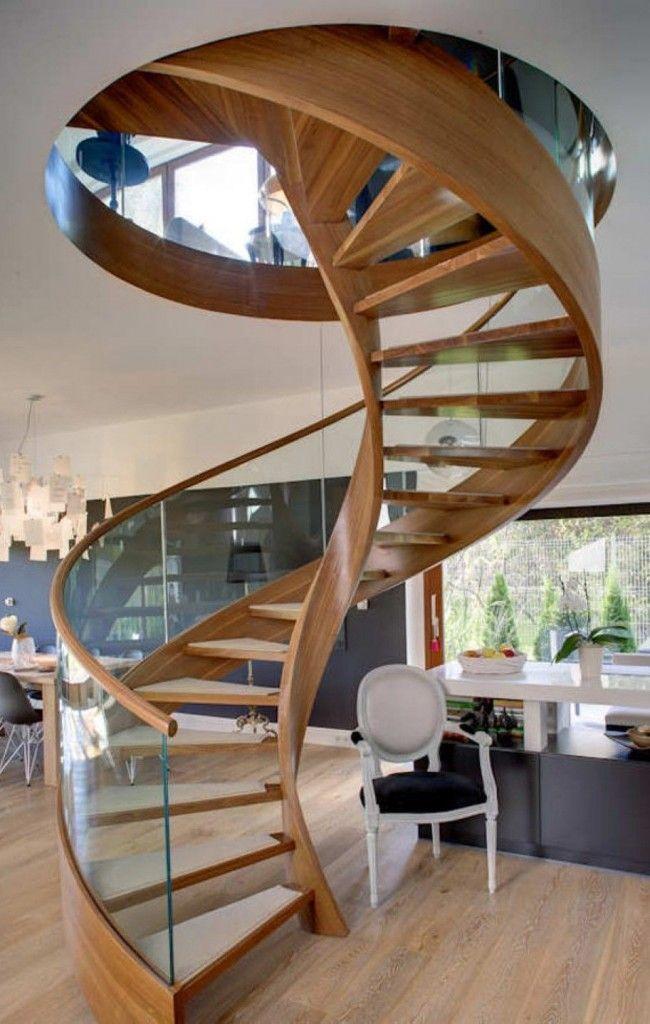 4. Самые сложные по монтажу и конструкции, но одни из красивейших – лестницы без привычного опорного столба. Крепятся ступени таких лестниц в тетивы, загнутые в форме спирали. Они же переходят в несущие перила.