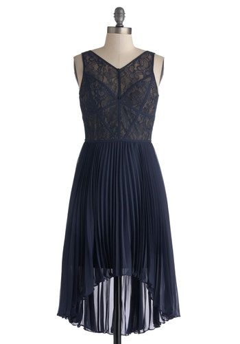 With a high-low hem that showcases your strappy metallic heels and an accordion-pleated skirt that makes even a simple step appear dramatically graceful, this flirty, sleeveless design has the cast doing a double take when you appear backstage before showtime. Compliments come rolling in when they all note the intersecting navy bands that divide the delicate lace overlay from the beige, padded bodice. Stage Choreographer Dress by Max and Cleo, #ModCloth